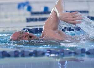 Man-Takes-a-Breath-While-Swimming-Laps
