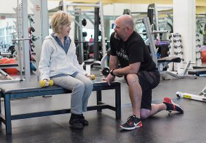 Fitness-Staff-Member-Talking-to-Lady