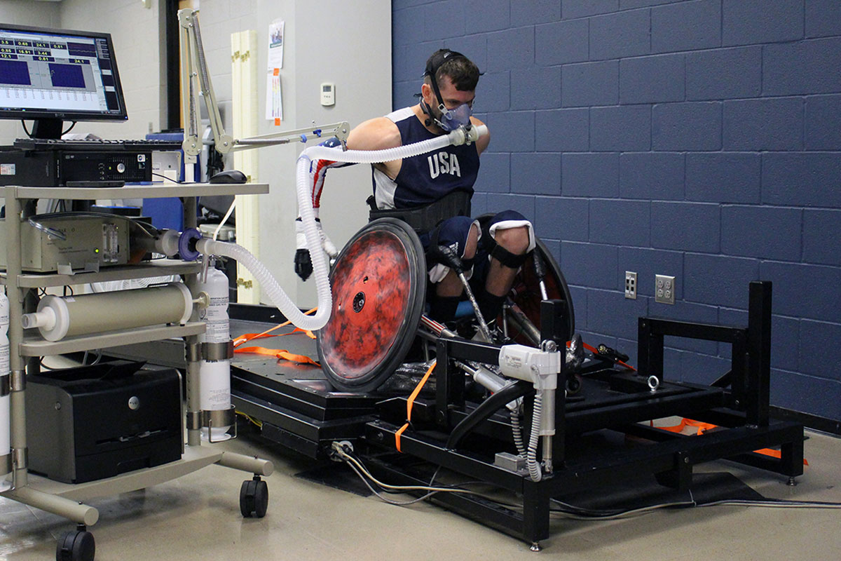 a wheelchair rugby play pushing on a wheelchair treadmill during a research study