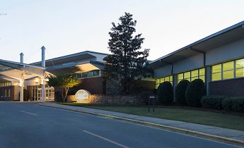 Driveway to the front of Lakeshore's main entrance with awning at sunset