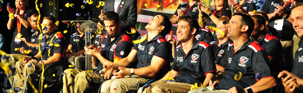 Confetti falls on USA wheelchair rugby players at celebratory event