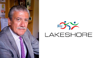 White man with gray hair and mustache wearing a gray suit and purple tie next to the Lakeshore logo